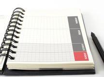 Planificateur vide de journal intime de plan rapproché avec le stylo Photo libre de droits