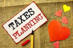 Planification des impôts des textes d'écriture Le concept signifiant des paiements financiers d'affaires d'imposition de planific Image stock