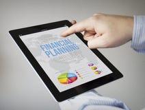 Planification financière sur un comprimé Photos libres de droits
