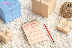 Planing gifts for Christmas with wish list Royalty Free Stock Photos