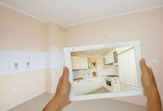 Planing new kitchen on tablet Royalty Free Stock Images