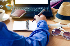 Planing for travel with laptop and notebook. Stock Images
