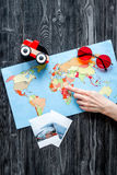 Planing trip with child with pictures and map dark background top view Royalty Free Stock Photography