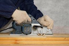 Planing the wood. With electric planer Stock Photography