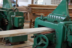 Planing of wood machine in workshop. Wood machine Stock Image
