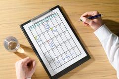 Planisty pojęcie na biurku Obrazy Stock
