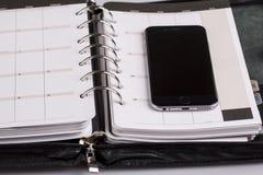 Planistyczny pojęcie - kalendarz, telefon komórkowy Obrazy Stock