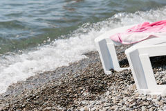 Plank bed on the pebble beach Stock Photo