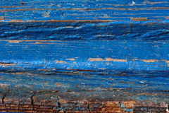 Plank benches. Worn wooden benches time board covered with blue paint Royalty Free Stock Photo