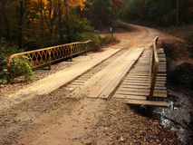 Plank Bridge on Dirt Road Stock Photo
