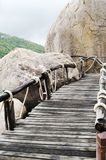 Plank bridge  and huge stones boulders, Koh Nanguan, Thailand Stock Photography