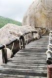 Plank bridge  and huge stones boulders, Koh Nanguan, Thailand Stock Photography