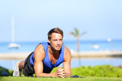 Plank core exercise - fitness man training Royalty Free Stock Photo