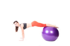 Plank on exercise ball Stock Images