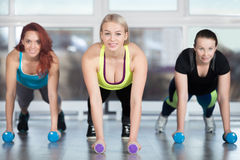 Plank exercise with dumbbells Stock Photo