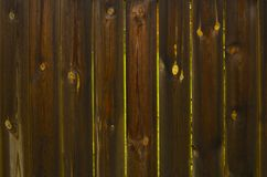 Plank fence. Fence from old wet planks with gaps between planks Stock Photos