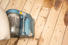 Plank floor and grinding machine with copy space Royalty Free Stock Photo