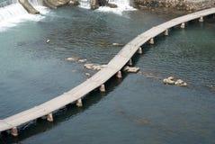 Plank floored bridge Stock Photos