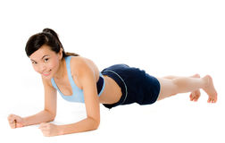 Plank Pose. A young attractive Asian woman in sportswear doing a plank pose royalty free stock image