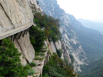 A plank road built along the face of a cliff Royalty Free Stock Image