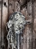 Old fishing net. Plank wall and old contaminated algae fishing net, rustic house, old house, wooden house, fishermans house stock photography
