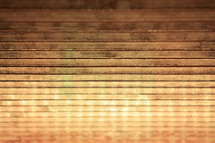 Plank wood with christmas lights reflection. Defocused lights reflection on plank wood. Useful background for christmas and general celebration Royalty Free Stock Photos