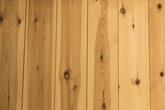 Plank wood logs on a wooden wall texture Royalty Free Stock Photography