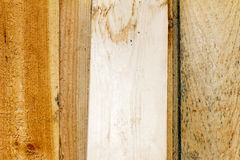 Plank of wood. Old and cracked. The surface is rough and uneven. Stock Image