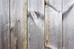 Plank of wood. Old and cracked. The surface is rough and uneven. Stock Photo