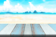 Plank wood or table top with Summer beach and sea water background. Can use for montage or display your product royalty free stock photo