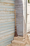 Plank wooden wall and a broom Stock Image