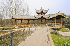 Planked footbridge to old-fashioned Chinese gallery Royalty Free Stock Photography
