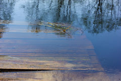 Planked footway under water. Stock Images