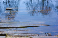 Planked footway under water. Royalty Free Stock Photo