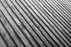 Planked roof of wooden shed. Striped repetitive planked roof of old wooden tool shed Stock Photos