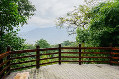 Planked viewing platform for visitors on mountainside in cloudy Stock Photography