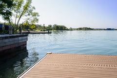 Planked waterside pier in sunny winter afternoon Stock Photos