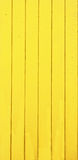 Planken des Holzes gelb gemalt - Vertikale Stockfotografie
