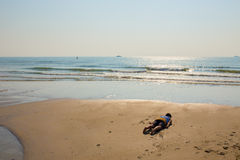Planking on the beach Royalty Free Stock Photo