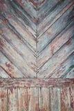 Plankor för den pastellfärgade röda tonen för Grunge texturerar wood bakgrund Arkivfoto