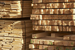 Planks. Piles of wooden planks at a sawmill stock image