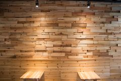 Planks brown wooden panel wall with two dimming downlight lights. From top background texture Stock Image