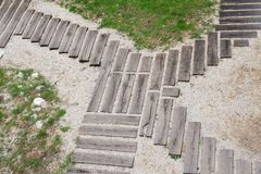 Planks form abstract shaped crossing of paths stock photography