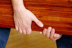 Planks in hands Stock Photography