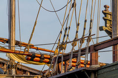 Planks, ropes, pulleys, tackle, and rigging of a replica of an old 1400's era sailing ship stock photos