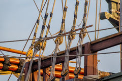 Planks, ropes, pulleys, tackle, and rigging of a replica of a 1400's era sailing ship Stock Images