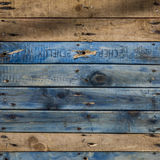Planks of weathered wood. Painted blue stock images