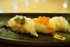planlägg praktiska sushi för laxen för elementmenyrestaurangen mycket Fotografering för Bildbyråer