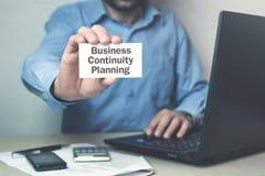 Planläggning för kontinuitet för affär för affärsmanvisningtext på affär arkivfoto
