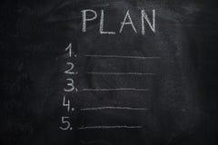 Planlijst op zwart bord stock foto
